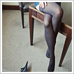 Long shapely legs in opaque stockings